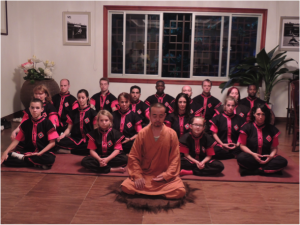 group meditation in China lead by a monk