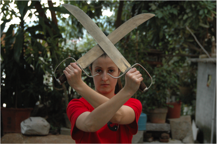 adult karate student posing with knives on China kung fu trip